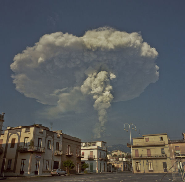 Sicily's east coast, an area of 1.600 square km, an altitude of nearly 3.340 meters, one of the most active volcanoes in the world. The power of Etna erupts again. The implacable force of his nature rips the silence of the night with explosions, tremors, flares, lava fountains. A new day dominated by spectacular clouds similar to atomic explosions. People's eyes the fear and the fear of those who know the fury of Muntagna. An indelible memory in the mind, a date: November 1928, the city of Mascali victim of Mount Etna Nature Mascali Eruption Mascali 1928 Erupting Lava Mountain Volcano Travel Photography Etna Volcano Etna, Mountain, Sicily, Fine Art Photography Etna; Perspectives; Nature Etnavolcano Etna Physical Geography Outdoors Majestic Journey Eyem Gallery Day