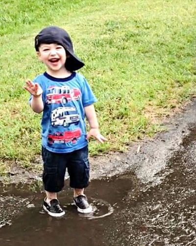 Puddles are so much fun!! Childhood Child One Person Standing One Boy Only Cap People Puddle Smile