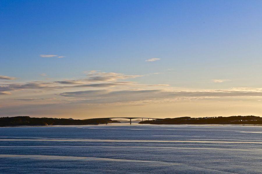 Elegant bridge link between islands Beauty In Nature Bridge Evening Sky Horizon Over Water Sea And Sky Silhoette Tranquil Scene Voyage