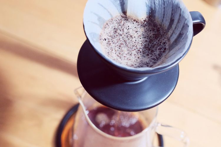 Make drip coffee ,barista pouring water on coffee ground with filter