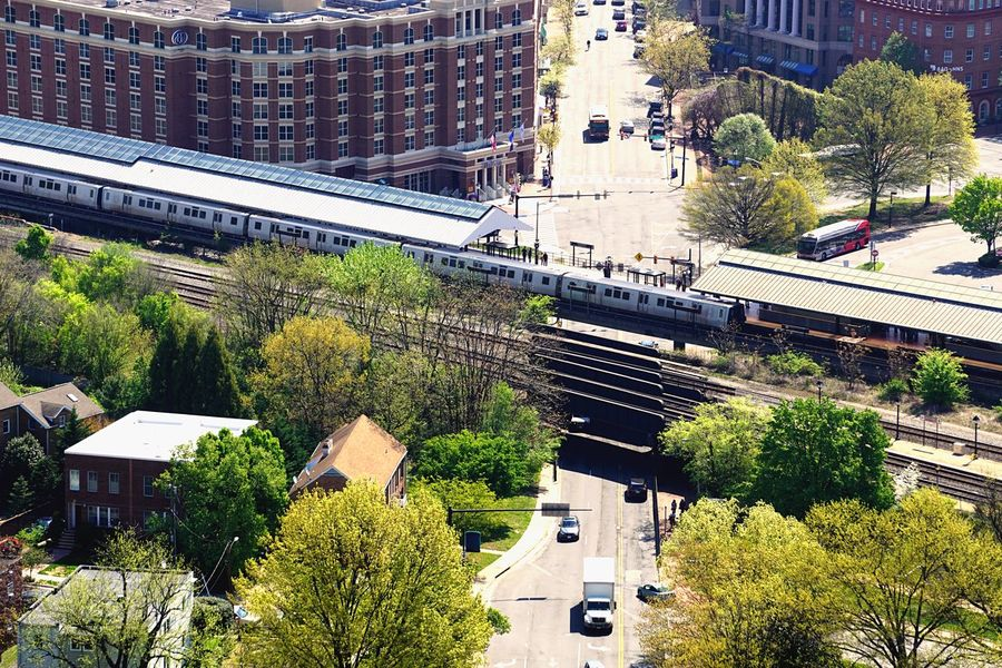 Metro Train Cityscape Urban Landscape Plant Built Structure Architecture Nature High Angle View Building Exterior Day Transportation Street Road City Outdoors