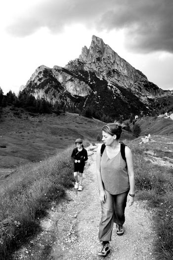 Adventure Backpack Beauty In Nature Casual Clothing Day Full Length Grass Hiking Landscape Leisure Activity Lifestyles Mountain Mountain Range Nature Outdoors Real People Rear View Scenics Sky Standing Togetherness Two People Walking Women EyeEm Ready   EyeEmNewHere An Eye For Travel