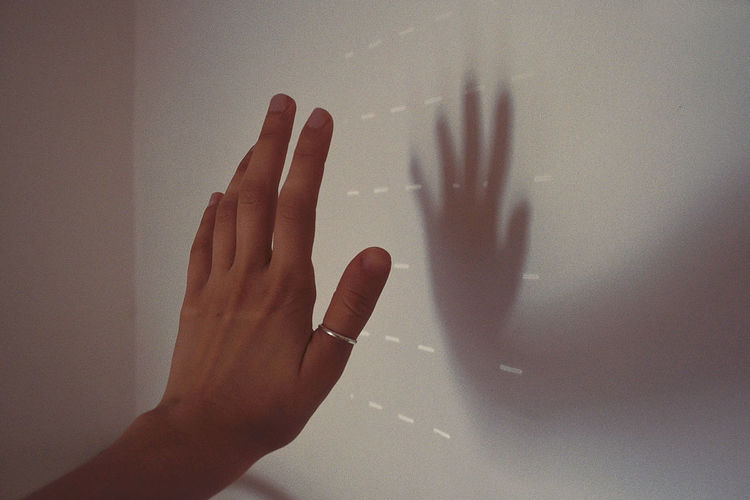 Light Sunlight Touch Wall Woman Body Part Day Daylight Finger Hand Human Body Part Human Finger Human Hand Indoors  Indoors  Lifestyles Light And Shadow One Person People Personal Perspective Real People Shadow Sun Unrecognizable Person Women Capture Tomorrow