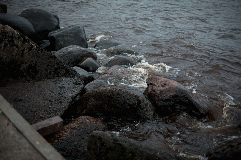 Water Rock Solid Sea Rock - Object Nature No People Motion Day Beach Land Outdoors High Angle View Beauty In Nature Wood Wood - Material Sport Wave Flowing Water Power In Nature Pollution