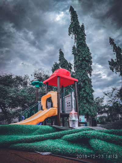 Low angle view of playground against sky
