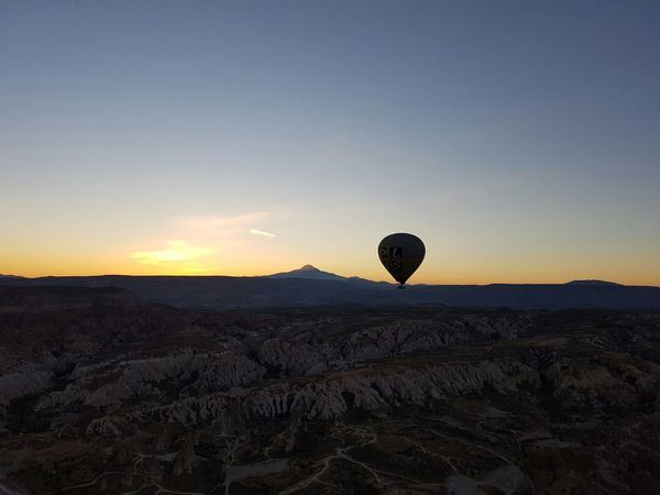 Sunset Clear Sky Hot Air Balloon Scenics Outdoors Horizon Over Land Remote Landscape Tranquil Scene Nature Sunset Landscape Tranquil Scene Tranquility Scenics Silhouette Mountain Clear Sky Hot Air Balloon Nature Beauty In Nature Outdoors Non-urban Scene Remote Dark