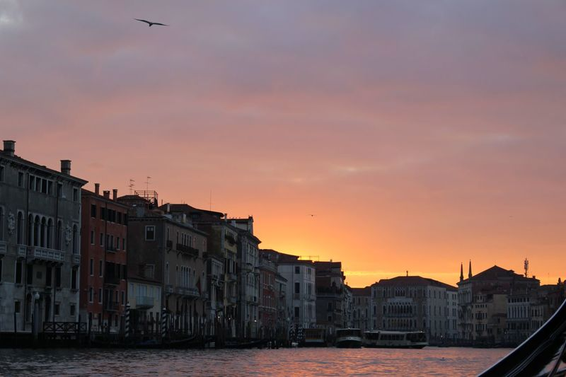Buildings in city against sky during sunset in venice