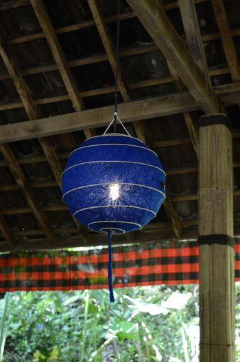 Blue paper lamp hanging from bamboo ceiling Bamboo Roof Blue Balloon Decoration Hanging Indonesian Style Lamp Paper Lamps Sphere Wood Blue Wave