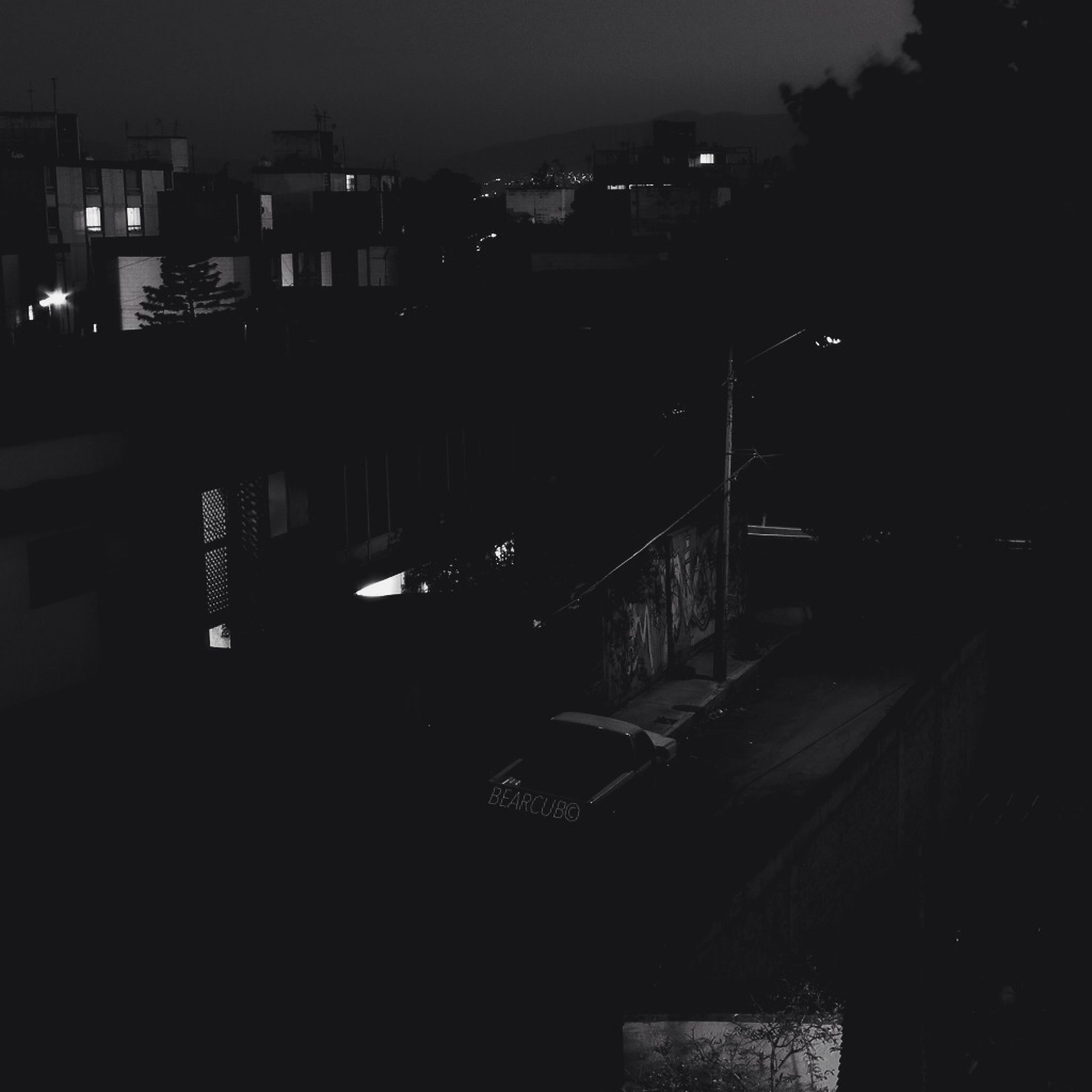 night, building exterior, illuminated, architecture, built structure, city, dark, residential structure, residential building, building, outdoors, street, sky, street light, house, residential district, city life, cityscape, no people, dusk