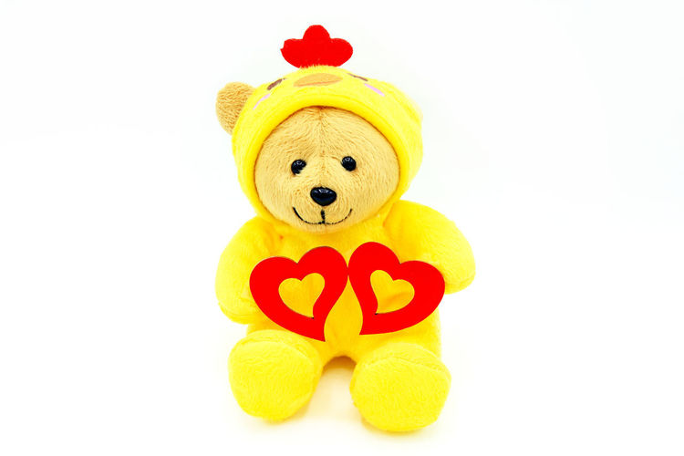 Close-up of yellow toy against white background