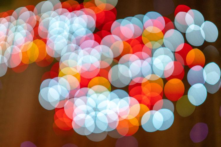 Illuminated Night Multi Colored Circle Geometric Shape Glowing Defocused Decoration Celebration Pattern Shape No People Christmas Lights Lighting Equipment Christmas Abstract Light - Natural Phenomenon Blurred Motion Light Event Lens Flare Disco Lights Purple Brightly Lit