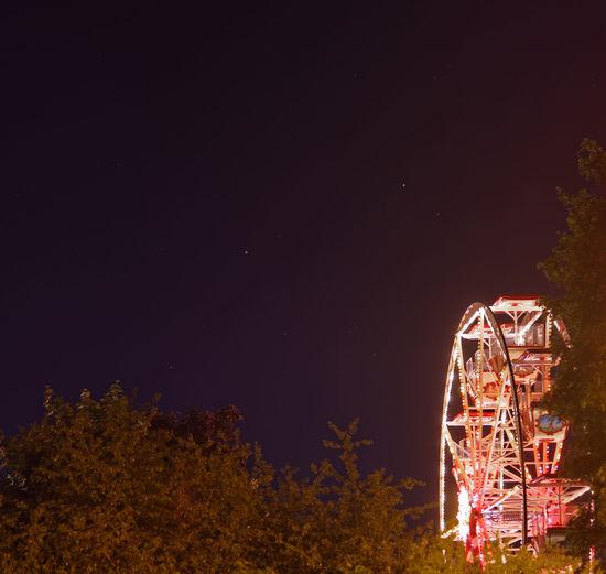Wasserfest Thekla 2017 in Leipzig Amusement Park Amusement Park Ride Arts Culture And Entertainment Carousel Ferris Wheel Ferris Wheel Illuminated Low Angle View Nature Night No People Outdoors Sky Star Star Field Stars Thekla Tree Wasserfest Wasserfest Thekla 2017