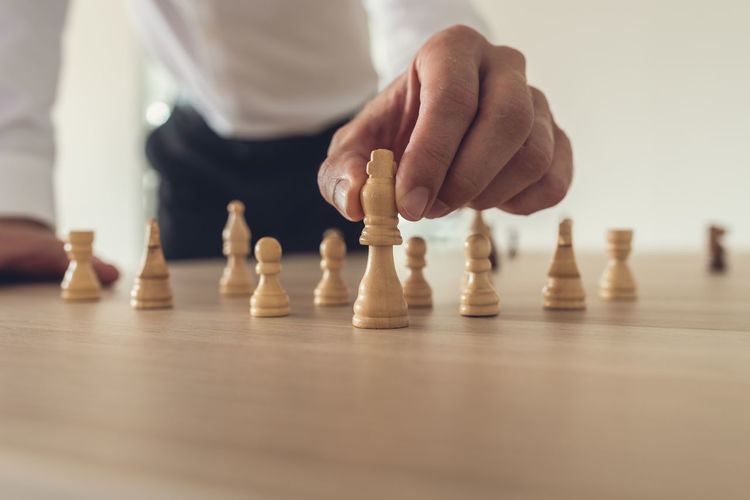 Close-up of man playing with chess
