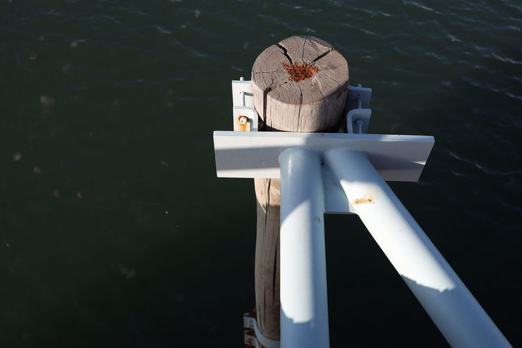 High angle view of toy on wooden post in lake
