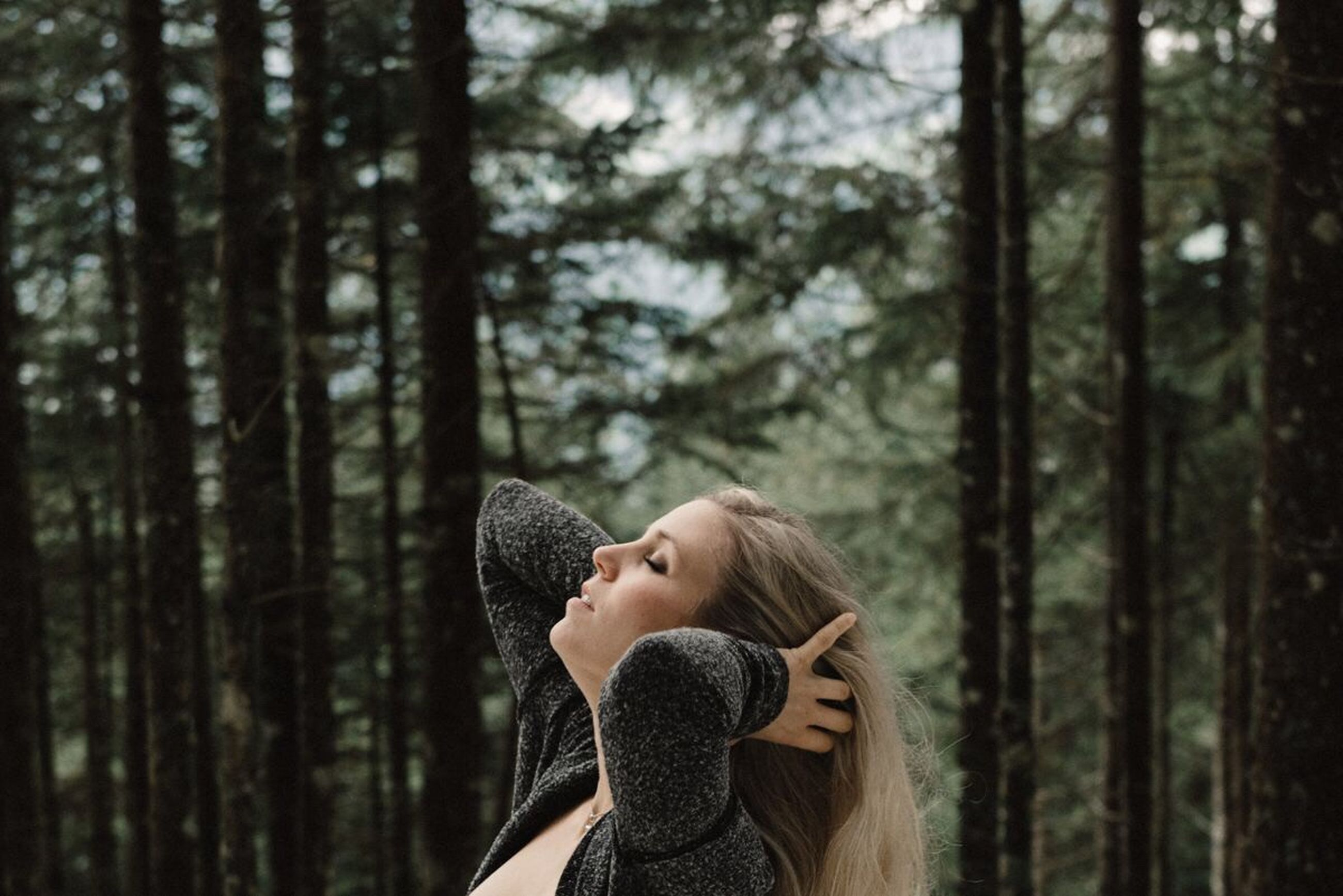 woodland, contemplation, adults only, beauty, only women, forest, young adult, adult, nature, headshot, one woman only, tree, outdoors, beautiful woman, people, women, one person, young women, sensory perception, warm clothing, day, real people, one young woman only, human body part