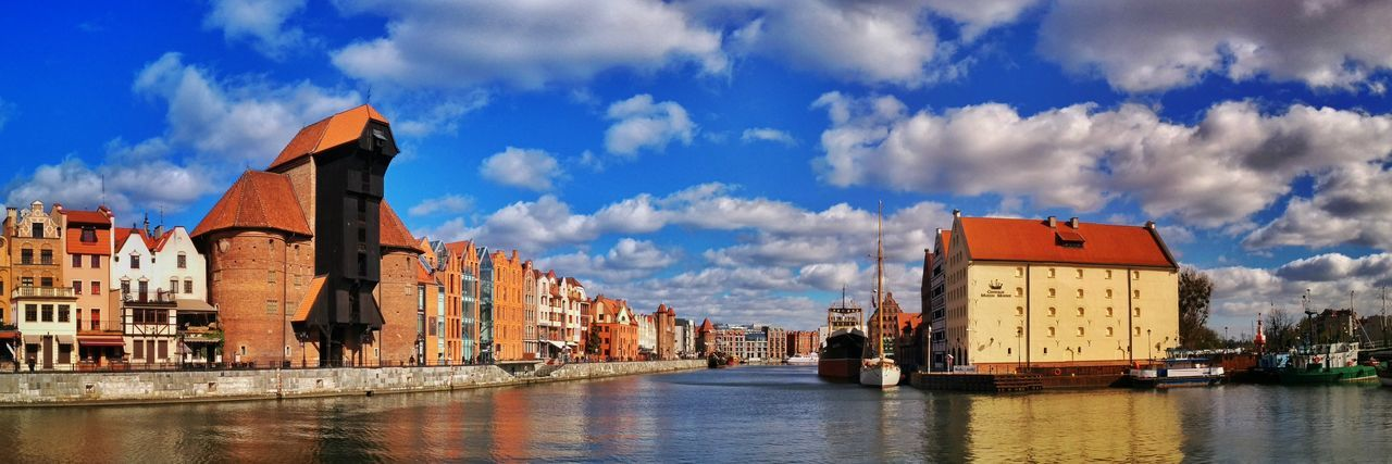 Panorama with the medieval port of Gdansk in Poland Port Medieval Harbor Harbour Panorama City Cityscape Gdansk Danzig, Poland Poland Danzig Travel Europe Sightseeing Landmark Building Crane Żuraw Motława River Water Summer Sky Day Outdoors Cloud - Sky