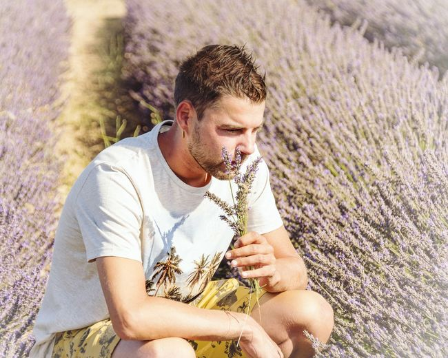 EyeEm Selects Agriculture Nature Holding Field One Person Outdoors Farmer Adult Men People One Man Only Growth Day Rural Scene Plant Lifestyles Only Men Smiling Farm Worker Human Hand Cereal Plant Summer Lavender Colored Lavenderflower