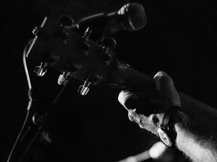 Concert Photography: Jazz Instruments: Guitar Head Arts Culture And Entertainment Close-up Focus On Foreground One Person Musical Instrument Music Indoors  Musical Equipment Real People Human Hand Selective Focus Hand Holding Guitar Human Body Part Night Low Angle View Black Background Guitar Head Watch Black And White Photography The Minimalist - 2019 EyeEm Awards