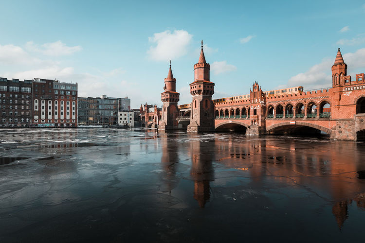 Bridge over frozen river in city