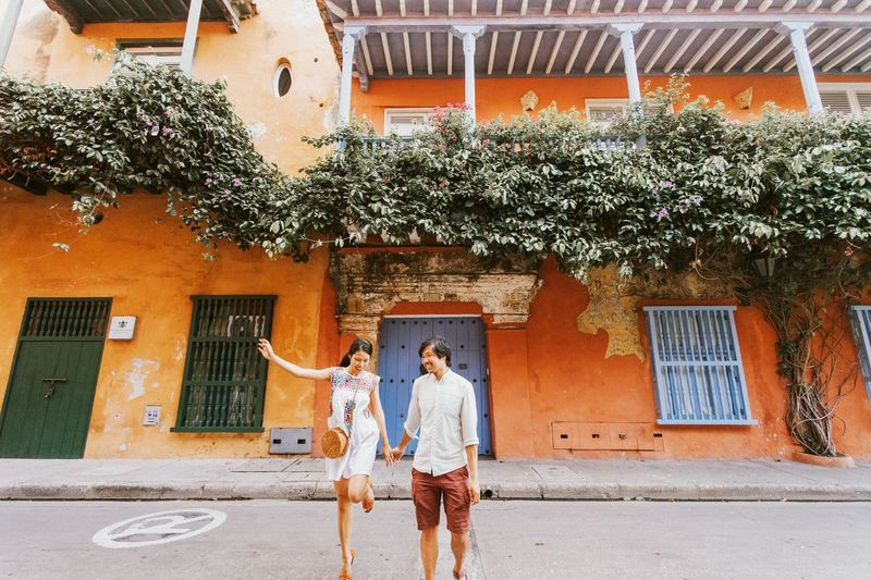 Couple Standing On Road By Building