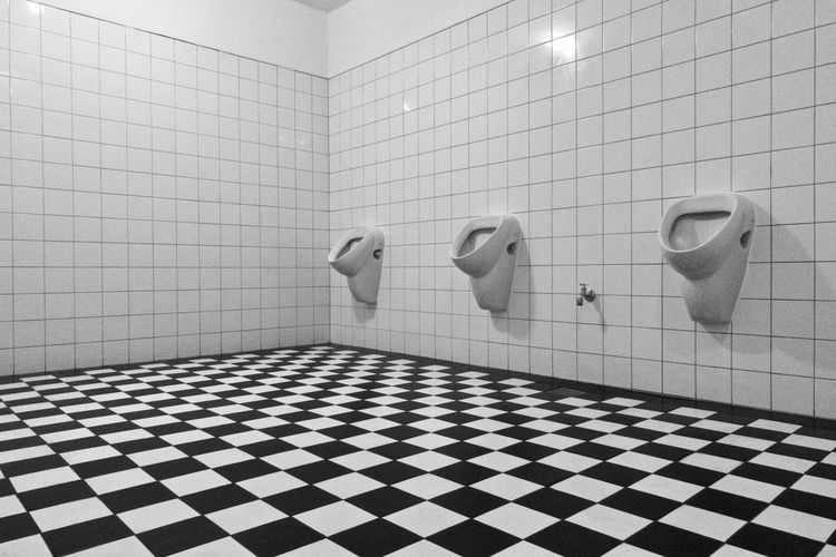 urinal in public restroom Black & White Checkered Restroom Room Service Toilet Urinal Wall Black And White Blackandwhite Checked Pattern Converging Lines Floor No People Nobody Three Tile Tiled Floor vanishing point