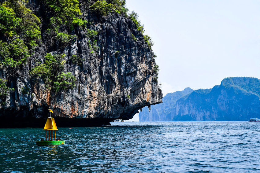 A trip in the Andaman Sea Rock Rock Formation Andaman Sea Rocks And Water Rocks In Water Rock Wall Water Nautical Vessel Longtail Boat Krabi Stone Geology Eroded Cliff Boat Rock Hoodoo