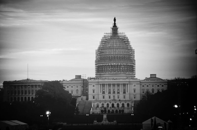 Democracy Under Construction US Capitol Building Blackandwhite My Best Photo 2014 I took this photo on a cold November morning, a week after an election which saw the Senate change hands and in the midst of a national controversy over race, justice and the rule of law. I am reminded that our founders intended for our government and its institutions to change as needed. That it is an imperfect thing. The scaffold around the dome means that it can and should be fixed before crumbling into decay. Portrait Of America Shades Of Grey
