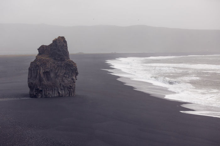 Black beach Dyrholaey, Iceland Beach Beauty In Nature Black Day Dyrhólaey Fog Iceland Landscape Minimalism Mist Monochrome Mountain Nature No People Nobody Outdoors Rock Rock - Object Scenics Sea Tranquil Scene Tranquility Volcanic Landscape Water Wave
