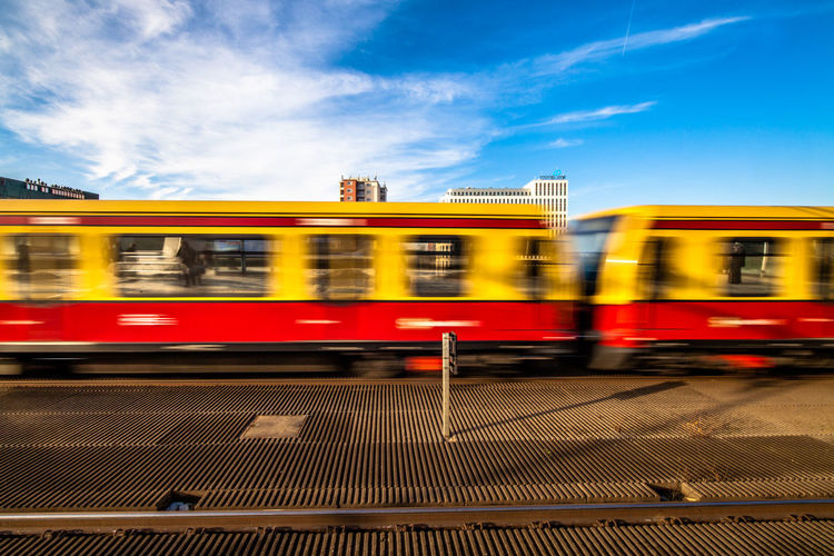 Yellow Train Moving Against Blue Sky