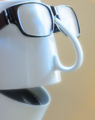 Anthropomorphic face made from coffee cups and eyeglasses