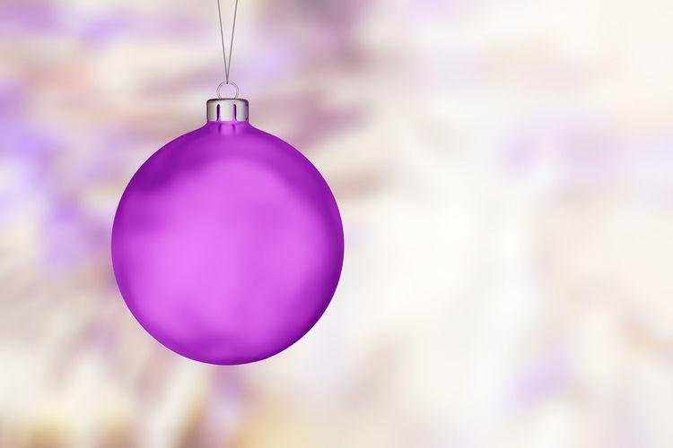Close-up of purple balloon hanging on christmas tree