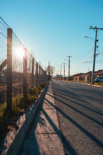 Sunlight Sky Nature Transportation Sun Clear Sky Shadow Lens Flare Sunbeam Day The Way Forward Cable No People Electricity  Road Architecture Electricity Pylon Direction Outdoors Built Structure Bright Power Supply