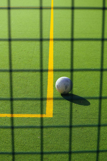 Artificial Grass Ball Close-up Day Football Net No People Outdoors Soccer Sport Sunlight Yellow Astro Turf Line Marking Sports Court Paint The Town Yellow