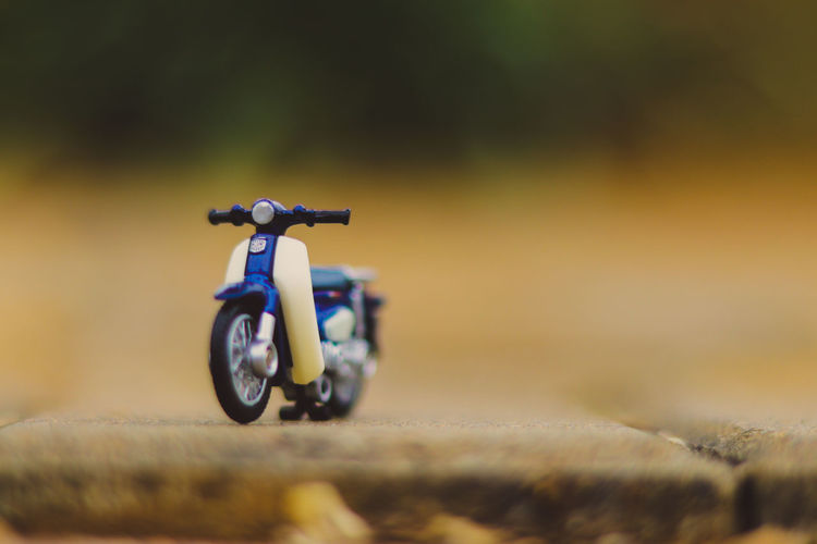 Close-up of toy motorcycle on road