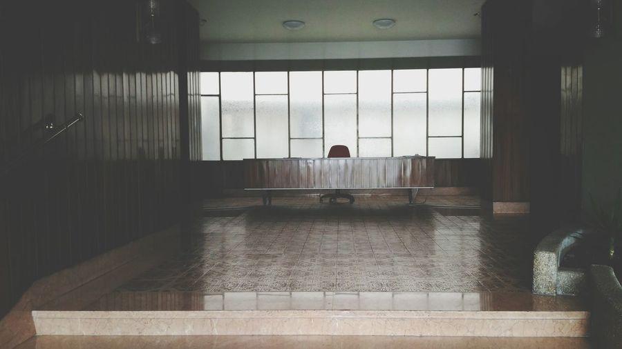 Man seen through glass window