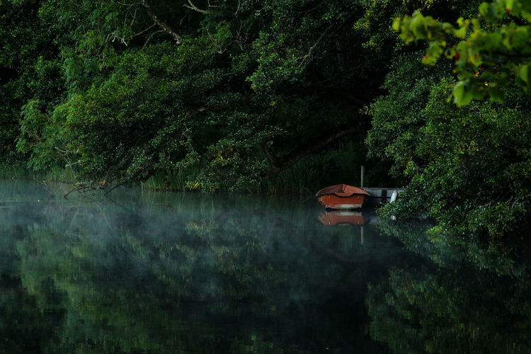 Wide Shot Of Boat Moored In River At Night