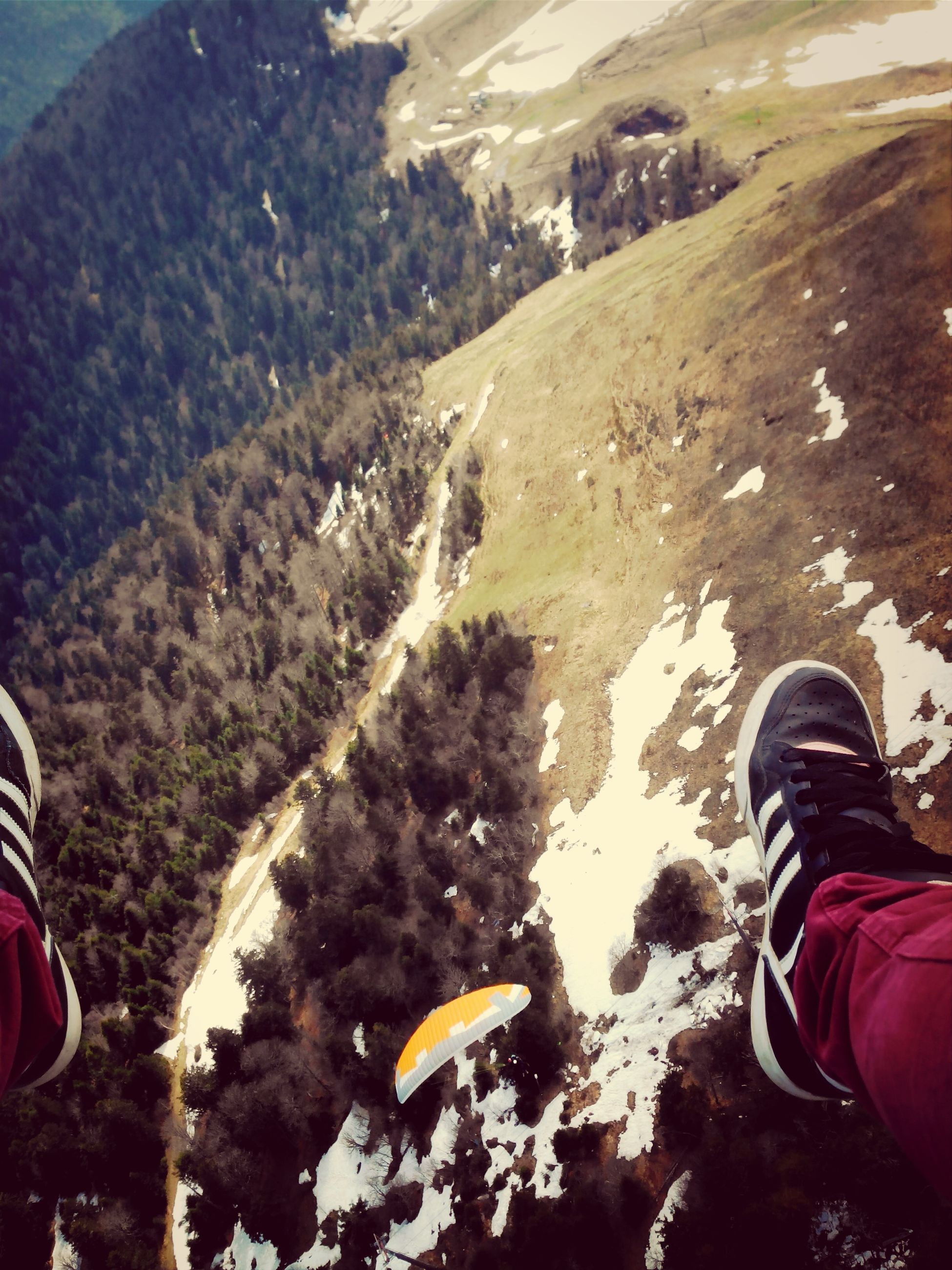 low section, lifestyles, shoe, leisure activity, person, men, personal perspective, high angle view, standing, unrecognizable person, footwear, rock - object, human foot, casual clothing, outdoors, landscape