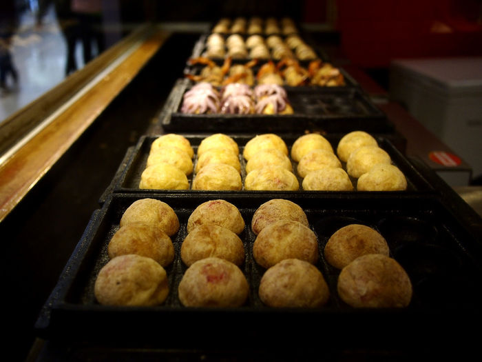 Assorted Takoyaki on display at a Japanese snack bar Food Food And Drink Asian  Japanese  Asian Foods Japanese Food Takoyaki Octopus Snack Time! Meal Appetizer Appetite Taste Restaurant Balls Grill Grilled Seafoods Health Healthy Eating Healthy Food Diet Nutrition