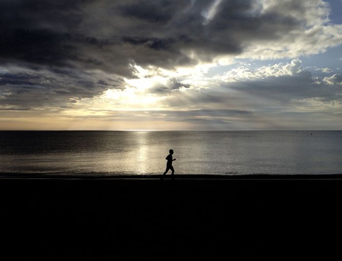 Lonely running on the beach Running SPAIN Beach Beauty In Nature Cloud - Sky Horizon Horizon Over Water Land Leisure Activity Nature One Person Outdoors Place For Text Real People Scenics - Nature Sea Silhouette Sky Sunset Tranquil Scene Tranquility Water