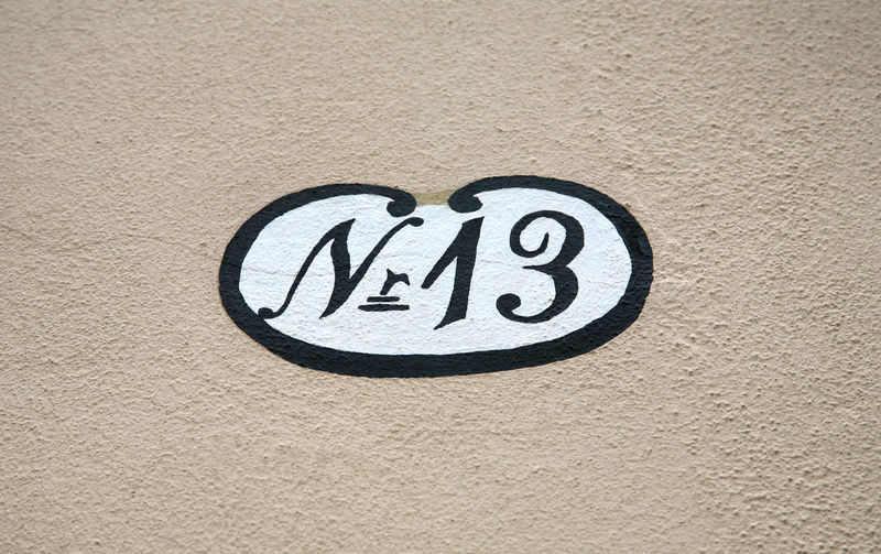 Antique hand painted street number 13 Antique Bad Luck Copy Space Façade Lucky Paint Text Architecture Black Building Exterior Built Structure Close-up Day Detail Frame Hand Drawn House Number No People Number Old Outdoors Street Number Symbol White
