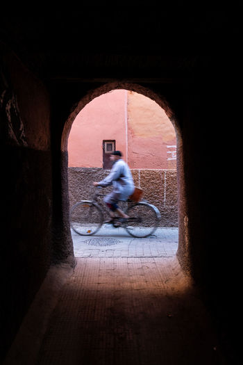 Man riding bicycle in tunnel