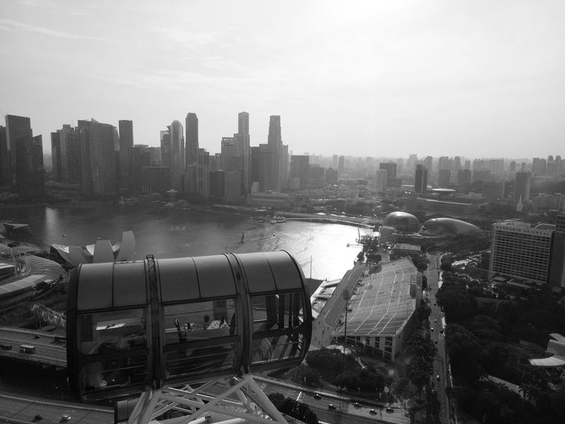 B&W view From the Flyer Architecture Asian Culture Bridge - Man Made Structure Building Exterior City Cityscape Day Flyer Flyer Singapore Flyer View Locomotive Mode Of Transport Outdoors Public Transportation Rail Transportation Railroad Track Singapore Singapore Flyer Sky Skyscraper Steam Train Top View Train - Vehicle Transportation Urban Skyline