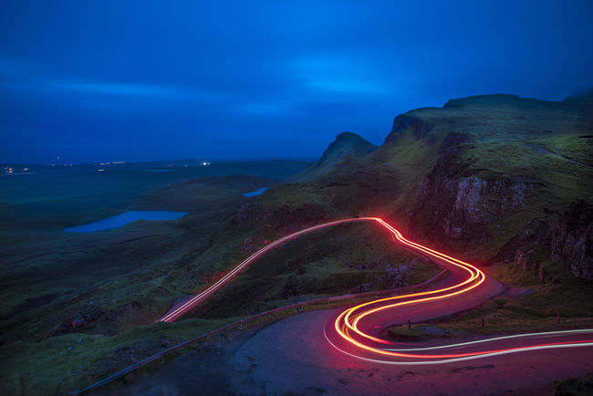 Quiraing Isle of Skye light trail Quiraing Isle Of Skye Scotland Scotland Highlands Night Road Mountain Light Trail Transportation Beauty In Nature Blue Curve Dusk Sky Long Exposure Scenics - Nature Winding Road High Angle View Landscape Outdoors Blue Hour Road Trip No People Nature