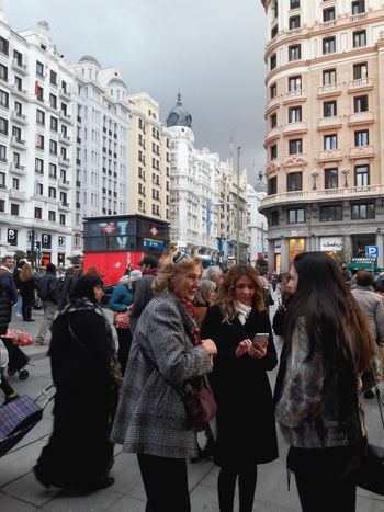 Embrace Urban Life Callao People Women Talking Street Photography Dark Clouds City Travel Cold Busy City City Life Architecture Editorial  Madrid Spaın Editorial  Clouds Dark Weather Street Street Callao Madrid