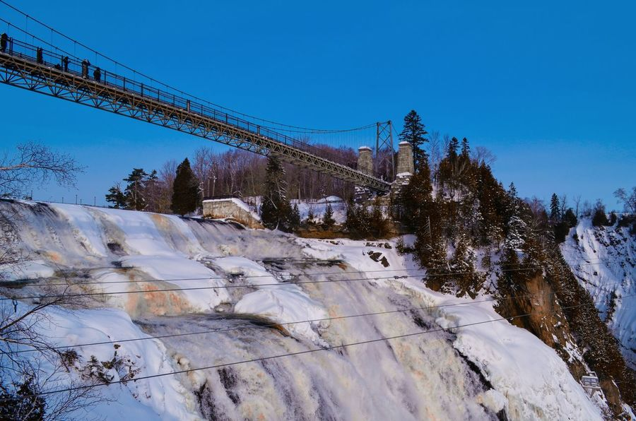Montmorency Falls Snow Cold Temperature Winter Sky Blue Landscape Nature No People Travel Destinations Outdoors Mountain Tree Day Beauty In Nature Ski Lift Tranquil Scene Eyeem Photography Fresh On Eyeem  High Angle View On Eyeem Falls Montmorency Falls Montmorencyfalls Montmorency  Frozen Minimalist Architecture