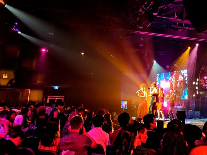 Popular Music Concert Fan - Enthusiast Performance Group Musician Crowd Audience Illuminated Nightlife Performance Concert Stage Atmosphere Entertainment Event Live Event