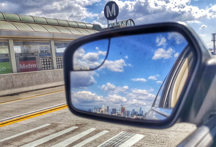 cruisin' down the street in my 6-4. Street Highway Roads Reflection Reflection Sky Travel Railroad Track Public Transportation City Cityscape Outdoors No People Day Nature