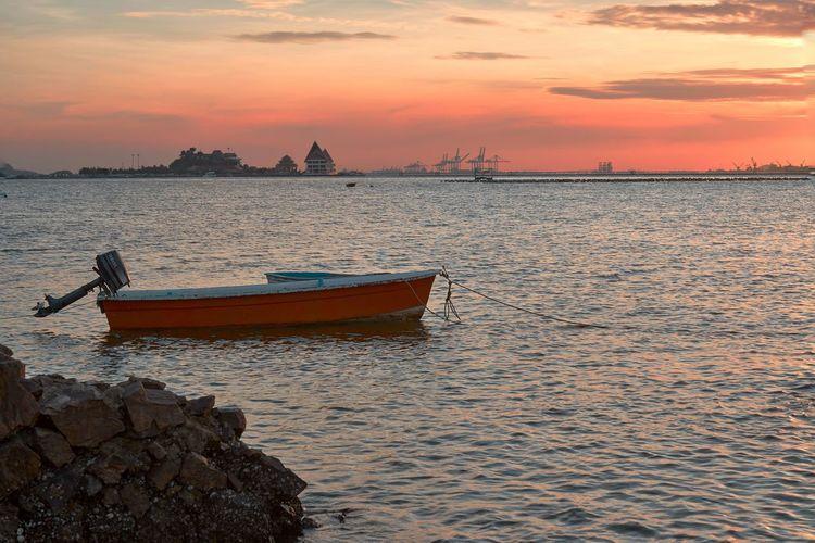 little boat Nautical Vessel Water Sunset Sea Beach Fisherman Urban Skyline Cityscape Sunlight Fishing Fishing Boat Trawler Rowboat Seascape