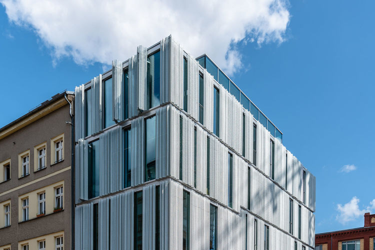 Modern office building with curtain wall and metal lattices in berlin mitte.