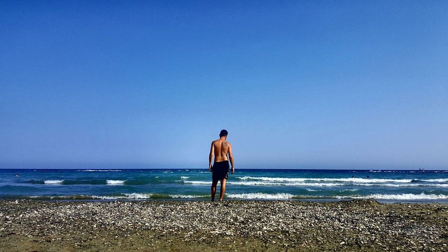 S6photography Mobilephotography S6 Cyprus Blue Sea Blue Sky Husband Beach Pebble Beach Waves Clear Sky Full Length Sea Water Beach Standing Men Rear View Blue Back Human Back Shore Wave Surf